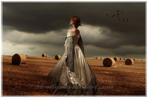 Image of a woman in a hayfield